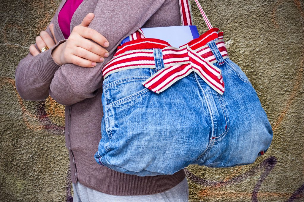 A Beginner's Guide to Upcycling: A denim bag upcycled from an old pair of denim pants